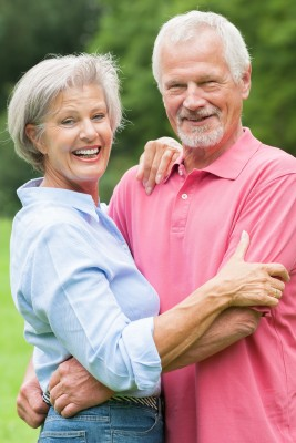 Happy older couple after treating sleep apnea