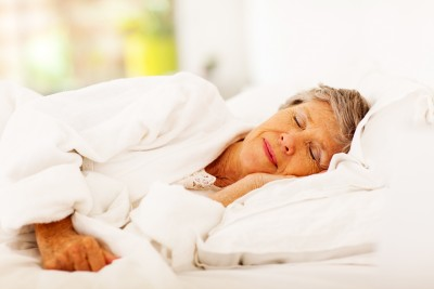 older woman sleeping well at night time